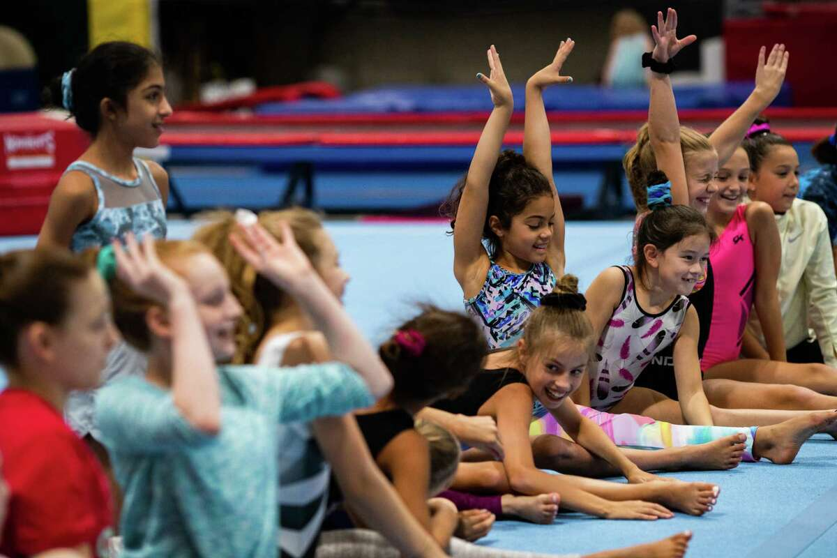 Young gymnasts practice at Discover Gymnastics on the day that legendary gymnast Simone Biles withdrew from the Tokyo Olympics, Tuesday, July 27, 2021, in Houston.