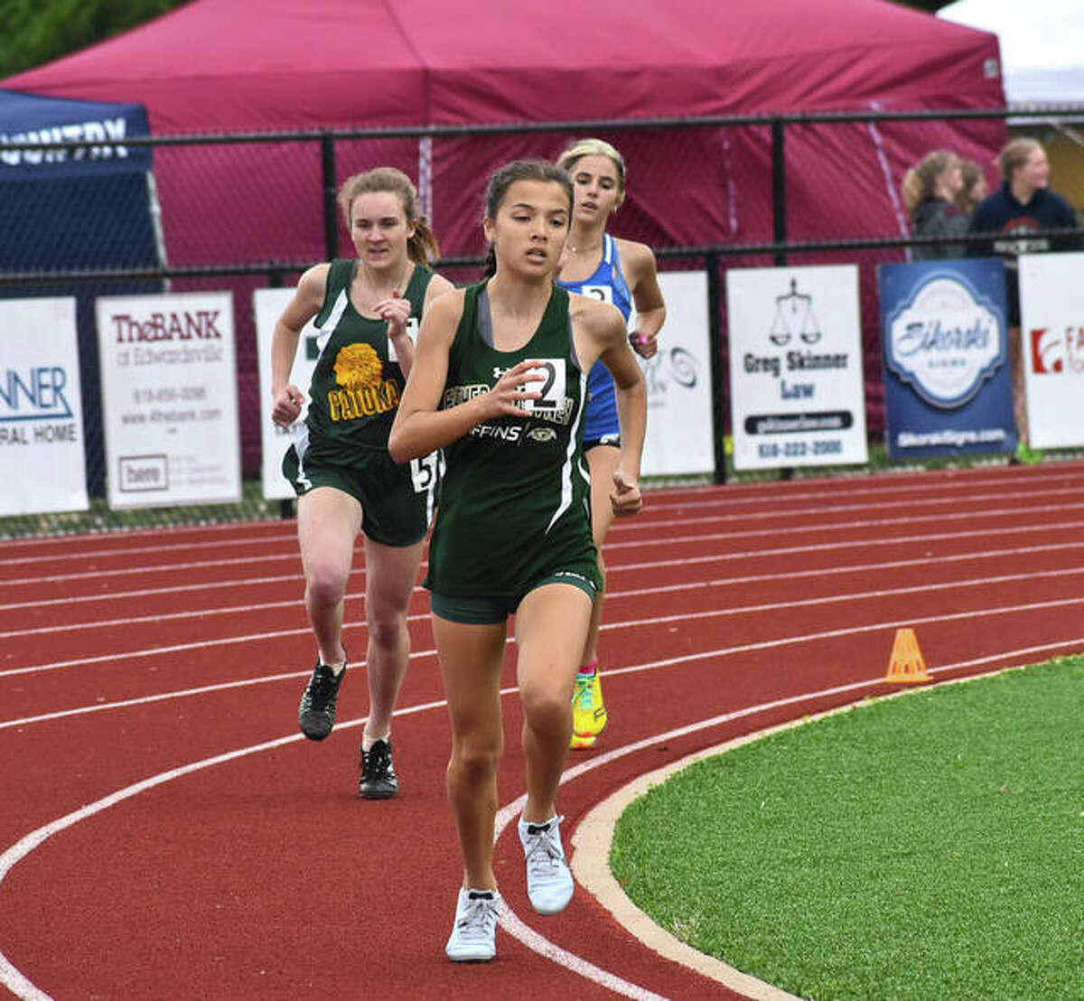 Father McGivney's Kaitlyn Hatley makes the turn around the 500-meter mark of the 800-meter run during the Class 1A Belleville Althoff Sectional.