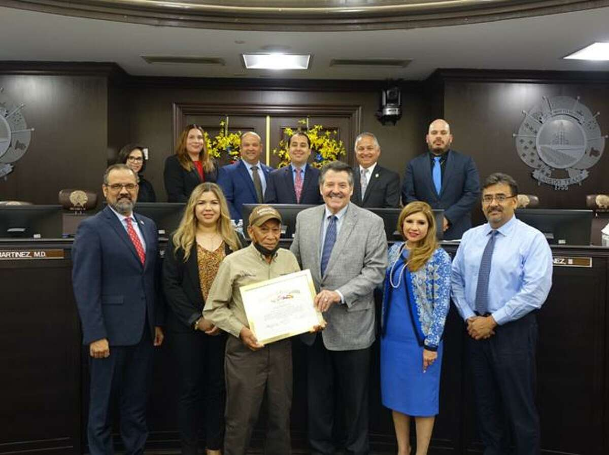 City of Laredo Mayor Pete Saenz with city councilmembers and management presenting the Employee of the Quarter recognition to Mr. Jose Renteria, Groundskeeper for Municipal Housing - Community Development Department.