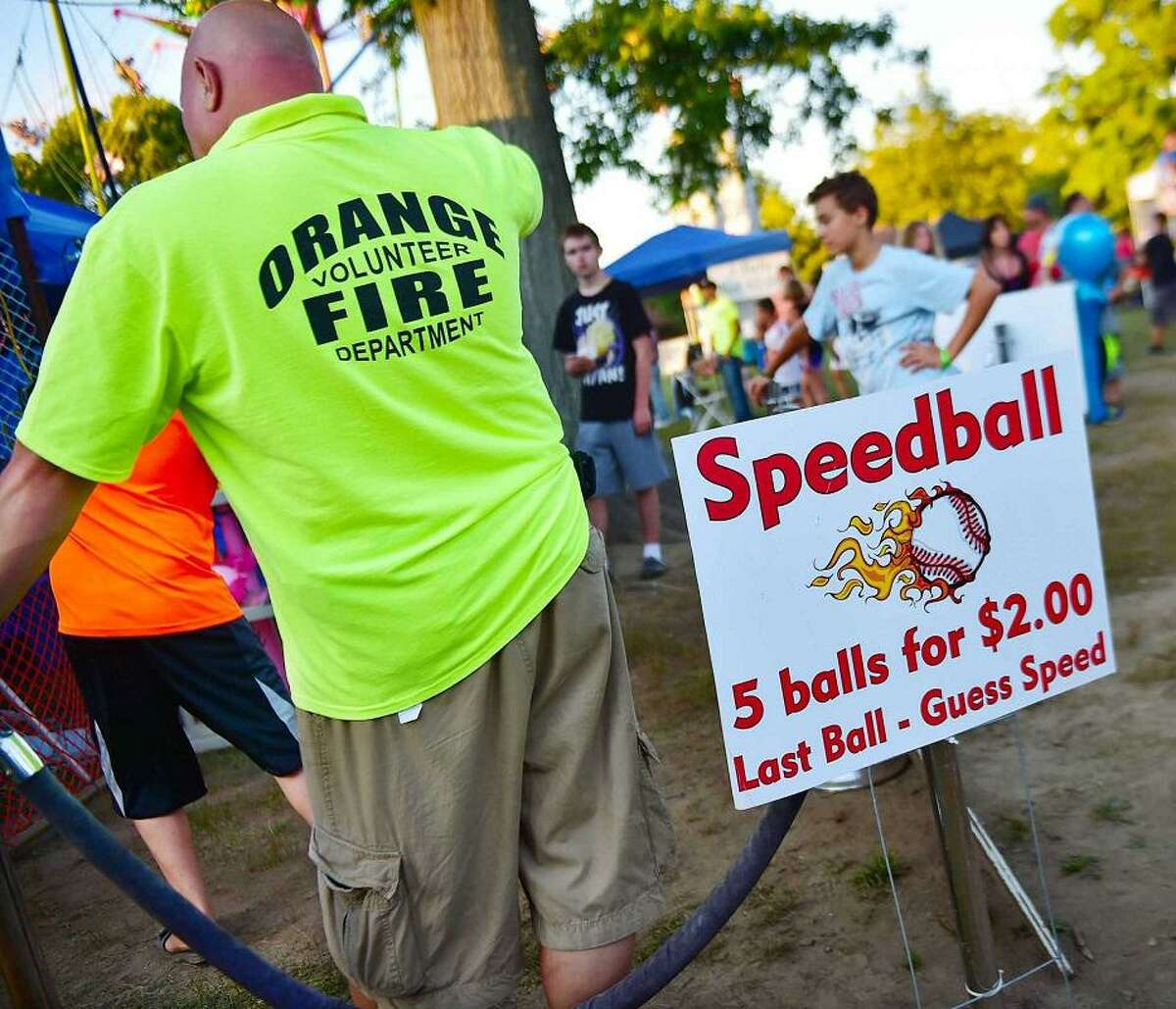 A volunteer steps up to help with games at a previous Orange Volunteer Firemen's Carnival.