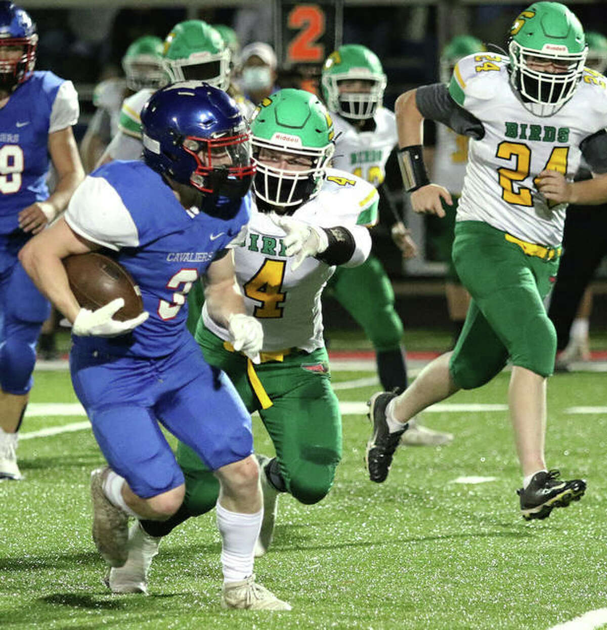 Carlinville's Bobby Seal (3) gets away from Southwestern's Blake Funk (4) during a SCC game April 9 in Carlinville. Seal, who rushed for 224 yards and four TDs in the Cavaliers' win over the Piasa Birds, is the 2020 Telegraph Small-Schools Football Player of the Year.