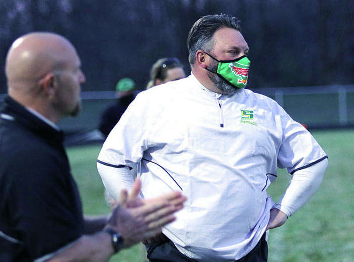 Southwestern coach Pat Keith (right) looks toward the field during a game last season at Knapp Field in Piasa. The Piasa Birds finished 5-1 and shared the SCC championship to earn Keith honors as the 2020 Telegraph Small-Schools Football Coach of the Year.