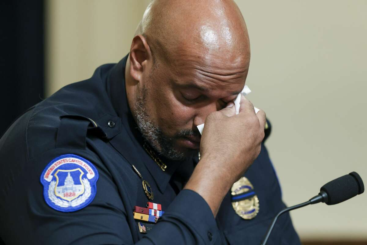 U.S. Capitol Police Sgt. Harry Dunn wipes his eye as he testifies during the House select committee hearing on the Jan. 6 attack on Capitol Hill in Washington, Tuesday, July 27, 2021. (Oliver Contreras/The New York Times via AP, Pool)