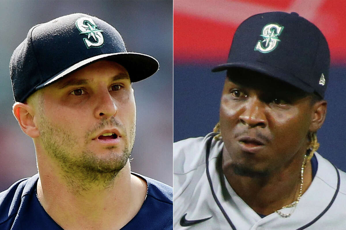 Kendall Graveman (left) and Rafael Montero are changing clubhouses after being acquired by the Astros from the Mariners before their game Tuesday in Seattle.