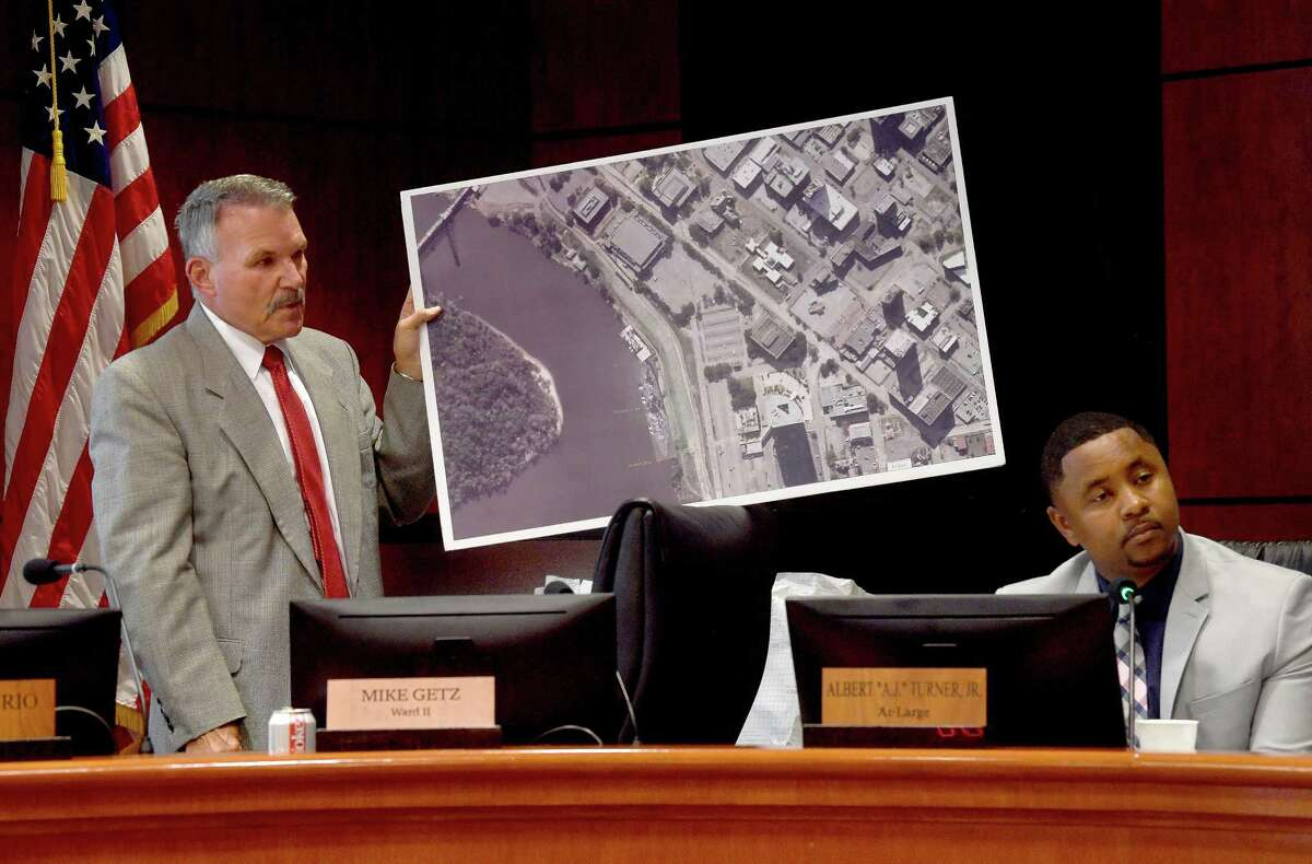 Councilman Mike Getz tries to offer a photo. of his proposed development ideas, but was cut short and the council proceeded to its vote during Tuesday's Beaumont City Council meeting in which the council voted to approve the city's purchase of the AT&T Building in a first step toward proposed riverfront development. Getz was the sole voice of dissent in the vote. Photo made Tuesday, July 27, 2021 Kim Brent/The Enterprise