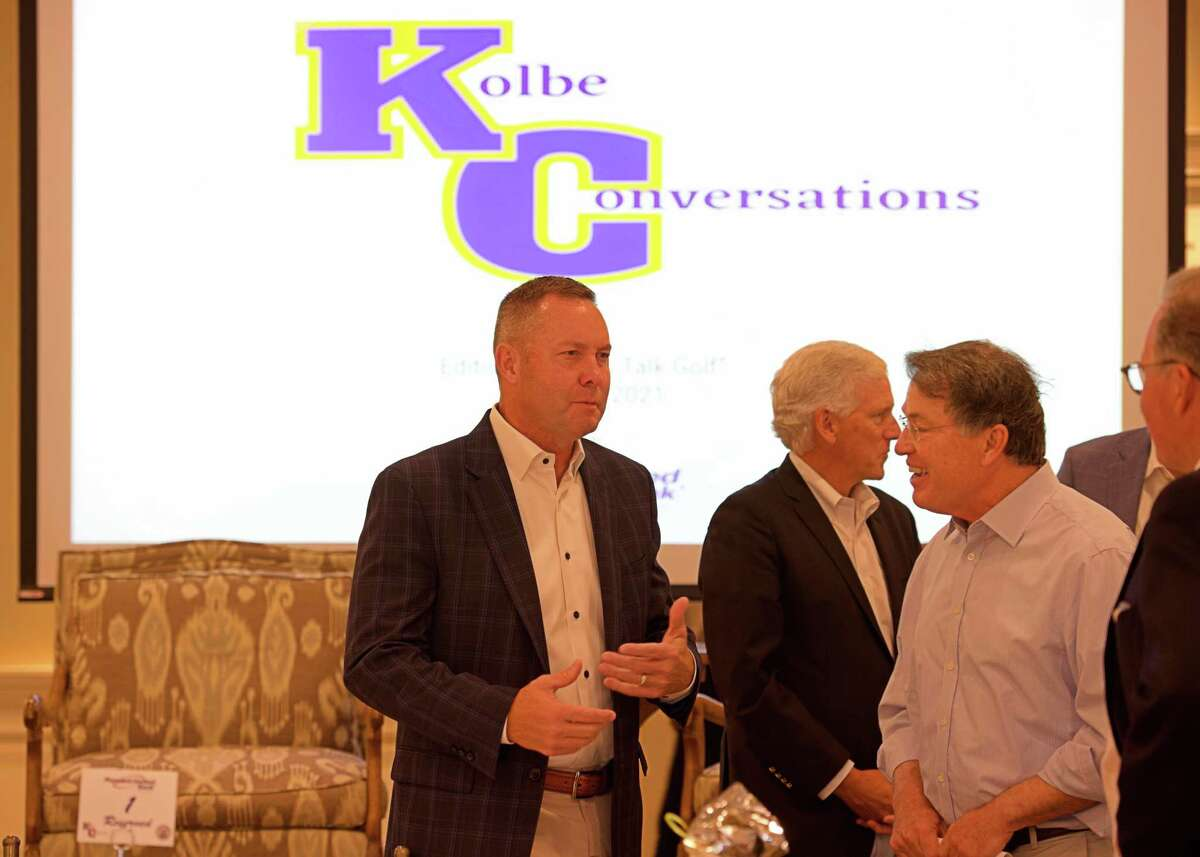 """New USGA CEO Mike Whan chats with a guest at the Kolbe Conversations """"Let's Talk Golf"""" held Tuesday at the Patterson Club in Fairfield."""