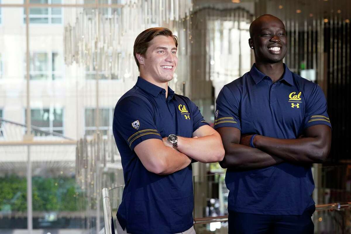 California quarterback Chase Garbers, left, and linebacker Kuony Deng pose for photos during the Pac-12's media day Tuesday.
