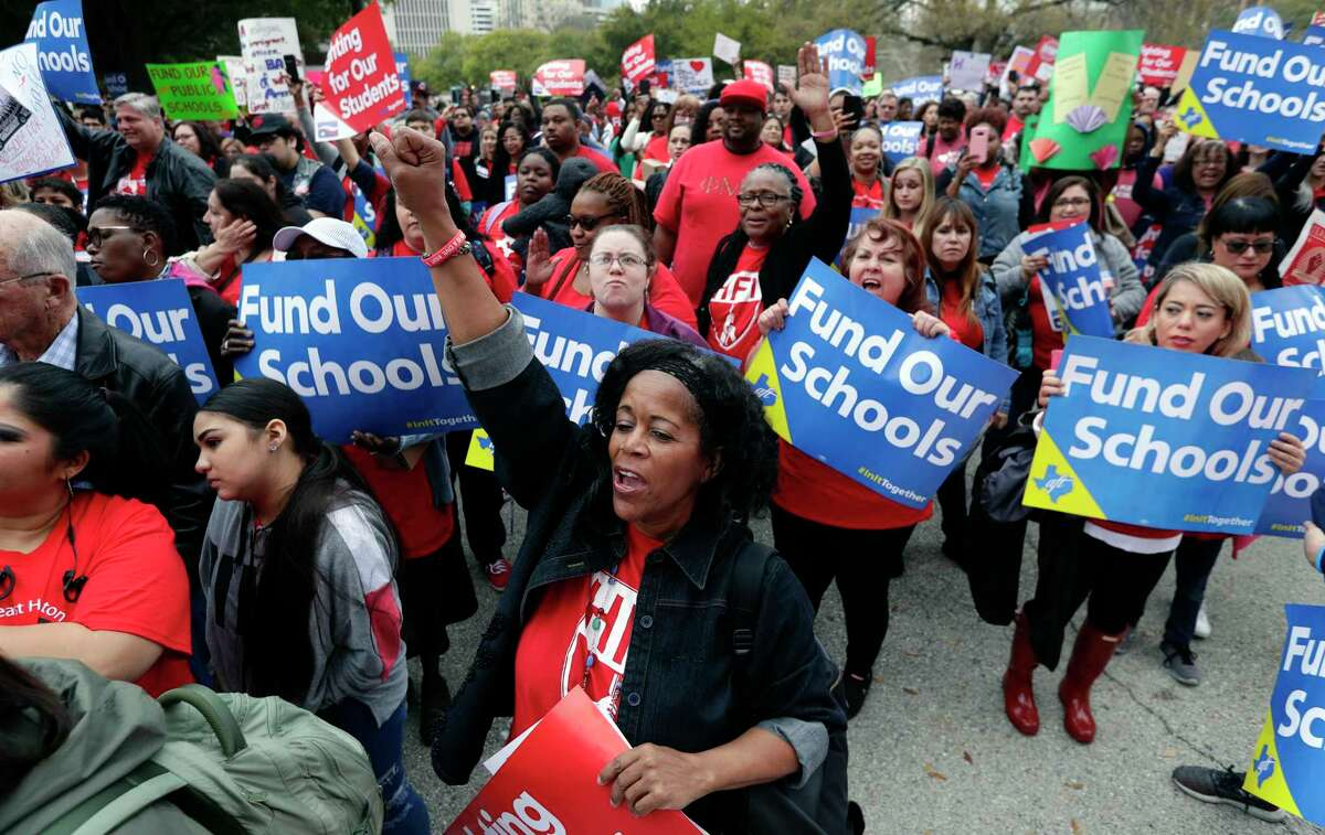 In this March 11, 2019 photo, educators rally to support funding for public schools in Texas at the state Capitol in Austin, Texas.