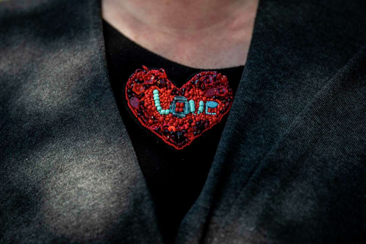 A heart-shaped decoration is seen on the shirt of Lydia Bransten, executive director of The Gubbio Project. The project offers homeless people a safe place to sleep and was in peril until donations from Chronicle readers began pouring in.