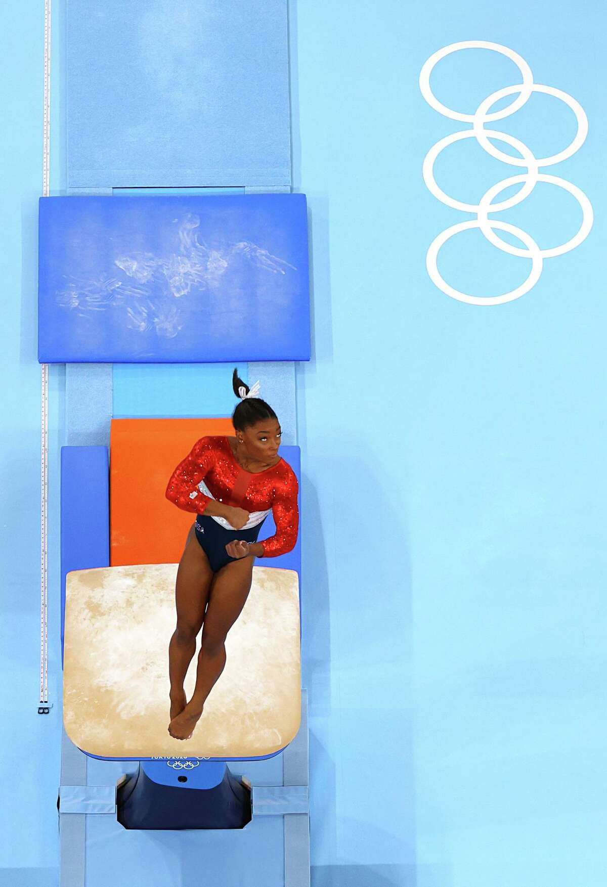 TOKYO, JAPAN - JULY 27: Simone Biles warms up on vault during the Women's Team Final on day four of the Tokyo 2020 Olympic Games at Ariake Gymnastics Centre on July 27, 2021 in Tokyo, Japan. (Photo by Laurence Griffiths/Getty Images)