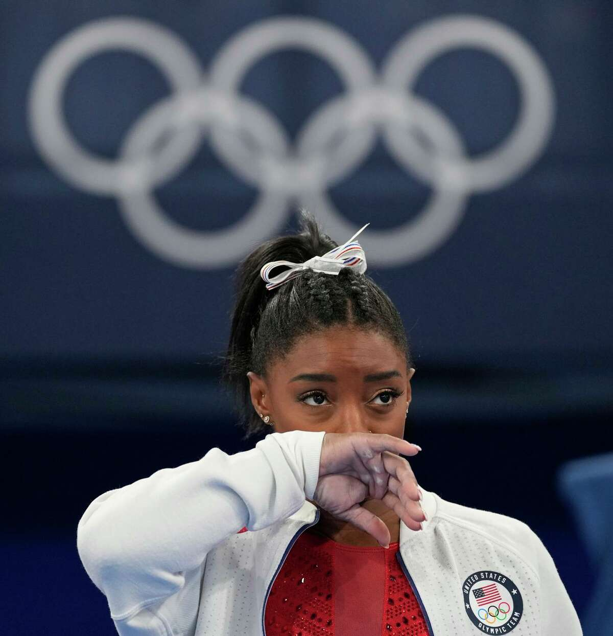 Four-time gold medalist Simone Biles left the women's gymnastics team final at the Tokyo Games because she feared she would get injured in a shaken state of mind.