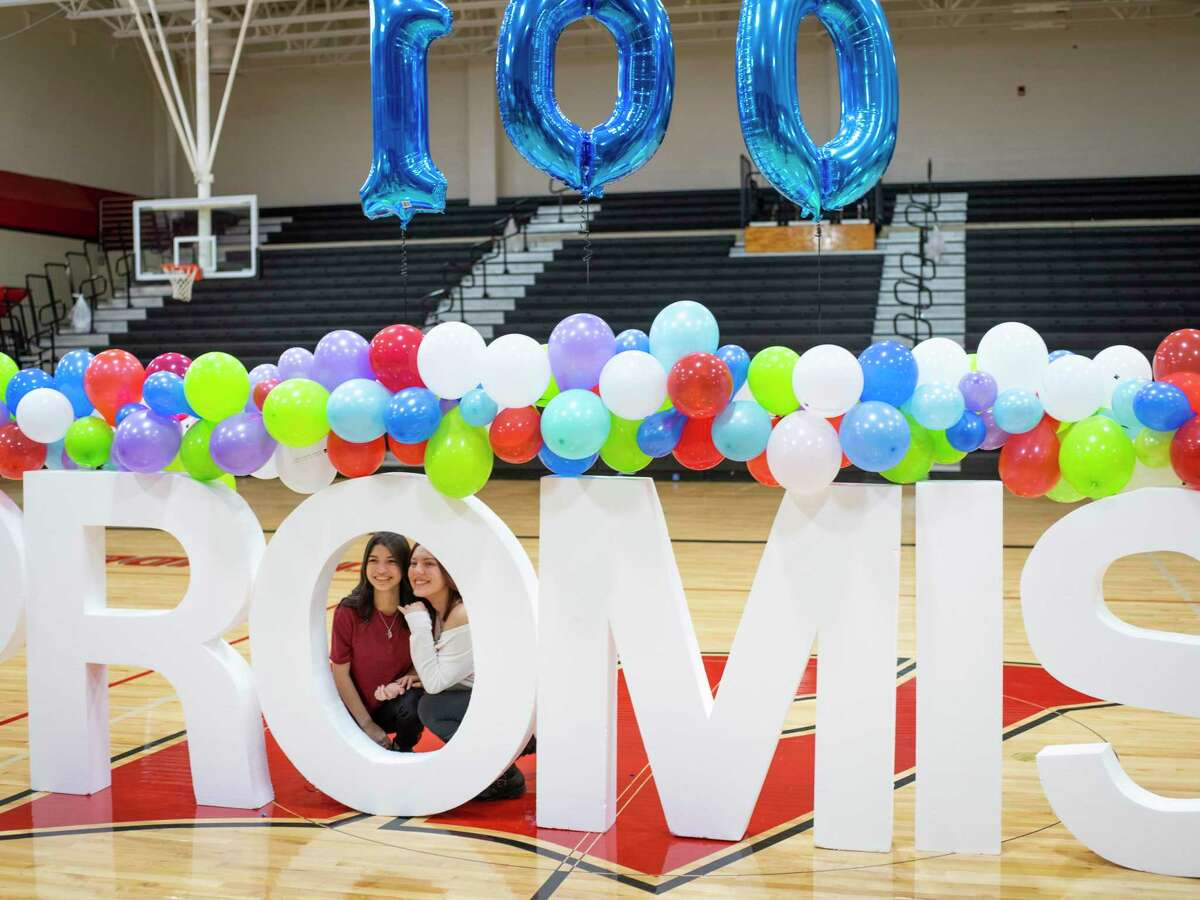 Seniors Alysia Delgado, left, and Alejandra Martinez, right, pose for a photo together during a pep rally for Alamo Promise at Karen Wagner High School as the program was launched in January, 2020.
