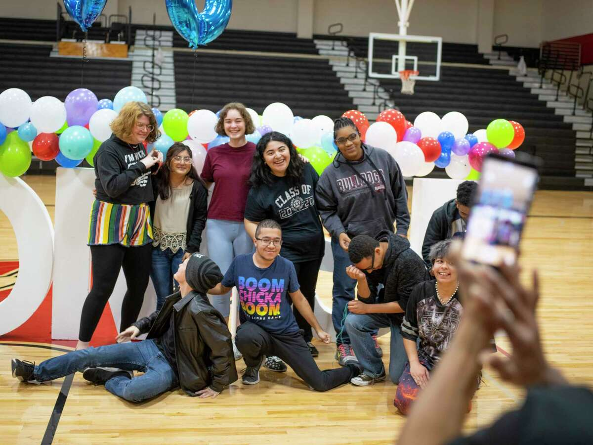 Seniors line up for a picture during a pep rally for Alamo Promise at Karen Wagner High School as the program was launched in January, 2020.