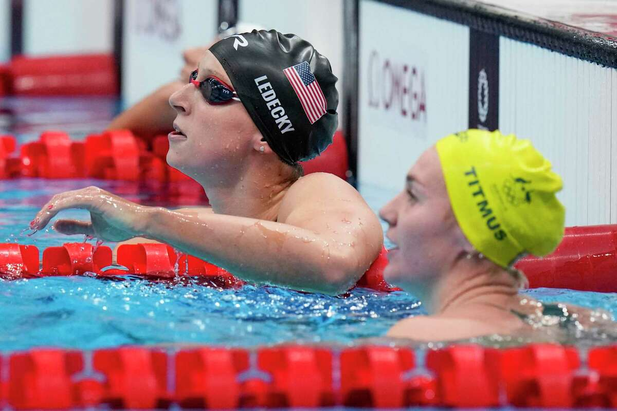 Katie Ledecky, of United States, facts after a women's 200-meter freestyle final at the 2020 Summer Olympics, Wednesday, July 28, 2021, in Tokyo, Japan. (AP Photo/Petr David Josek)