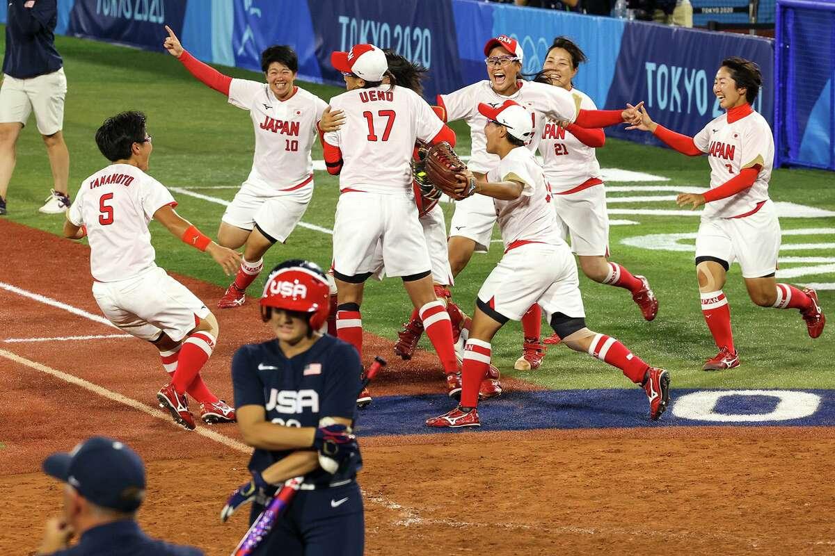 Team Japan celebrate a 2-0 win over the USA Women's Softball team for the Gold Medal at Yokohama Stadium in Yokohama, Japan on Tuesday, July 27, 2021. (Robert Gauthier/Los Angeles Times/TNS)