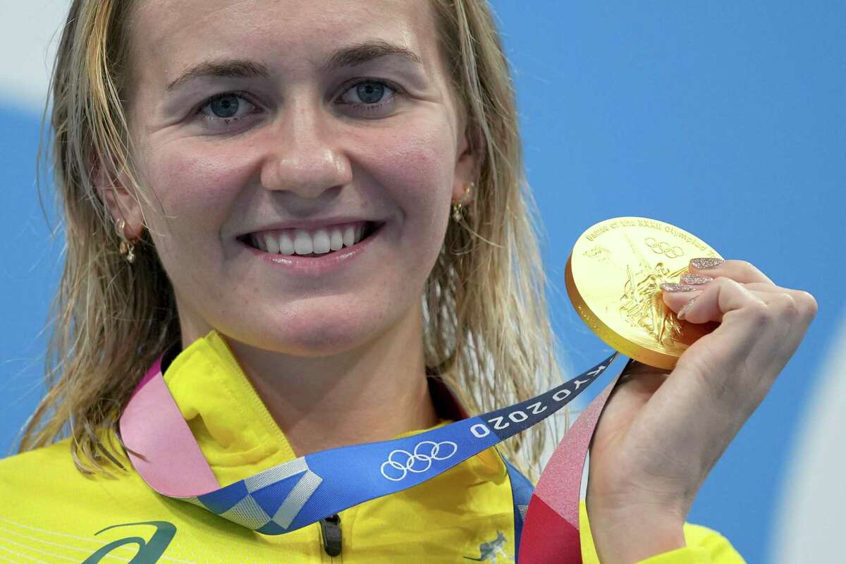 Ariarne Titmus of Australia holds up her gold medal after winning the women's 200-meter freestyle final at the 2020 Summer Olympics, Wednesday, July 28, 2021, in Tokyo, Japan.