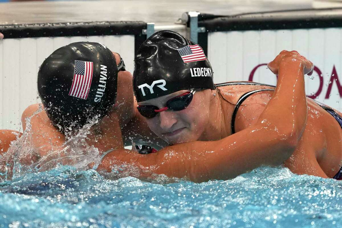 Katie Ledecky, right, of the United States, embraces compatriot Erica Sullivan after winning the women's 1500-meters freestyle final at the 2020 Summer Olympics, Wednesday, July 28, 2021, in Tokyo, Japan.