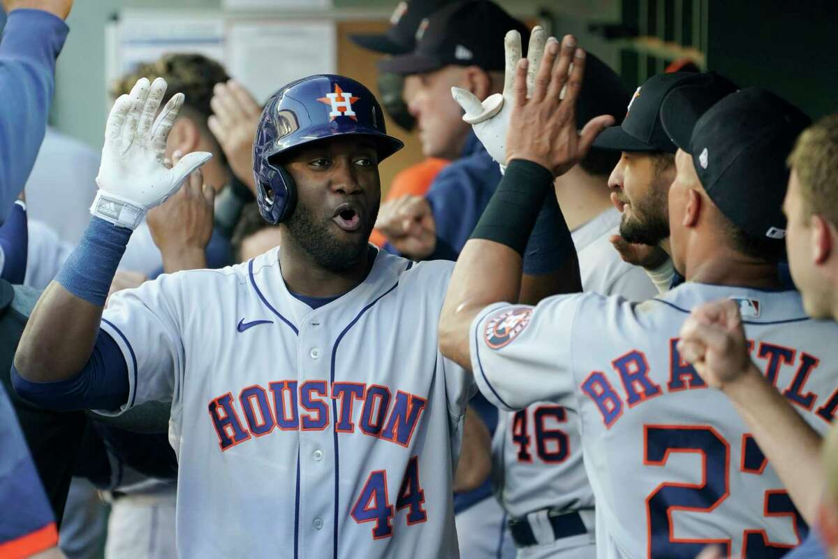 The Astros' Yordan Alvarez (44) is greeted in the dugout after he hit a three-run home run during the first inning of Tuesday's victory in Seattle.