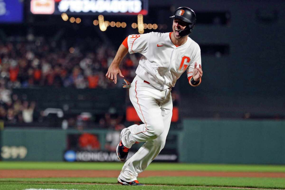 San Francisco Giants' Buster Posey reacts to a throwing error by Los Angeles Dodgers' Cody Bellinger allowing him to score go ahead run in 8th inning during MLB game at Oracle Park in San Francisco, Calif., on Tuesday, July 27, 2021.