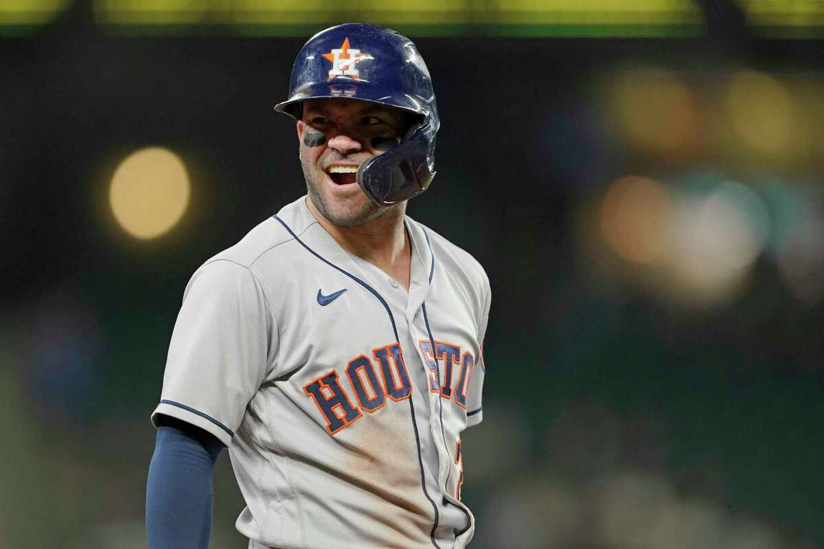 Houston Astros' Jose Altuve reacts after reaching third base during the eighth inning of the team's baseball game against the Seattle Mariners, Tuesday, July 27, 2021, in Seattle. (AP Photo/Ted S. Warren)