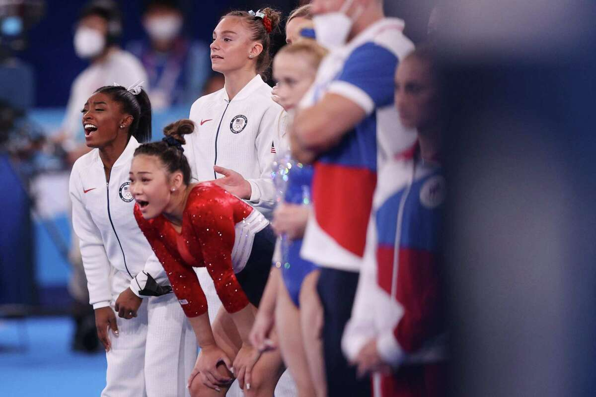 TOKYO, JAPAN - JULY 27: Simone Biles of Team United States cheers during the Women's Team Final on day four of the Tokyo 2020 Olympic Games at Ariake Gymnastics Centre on July 27, 2021 in Tokyo, Japan. (Photo by Ezra Shaw/Getty Images)