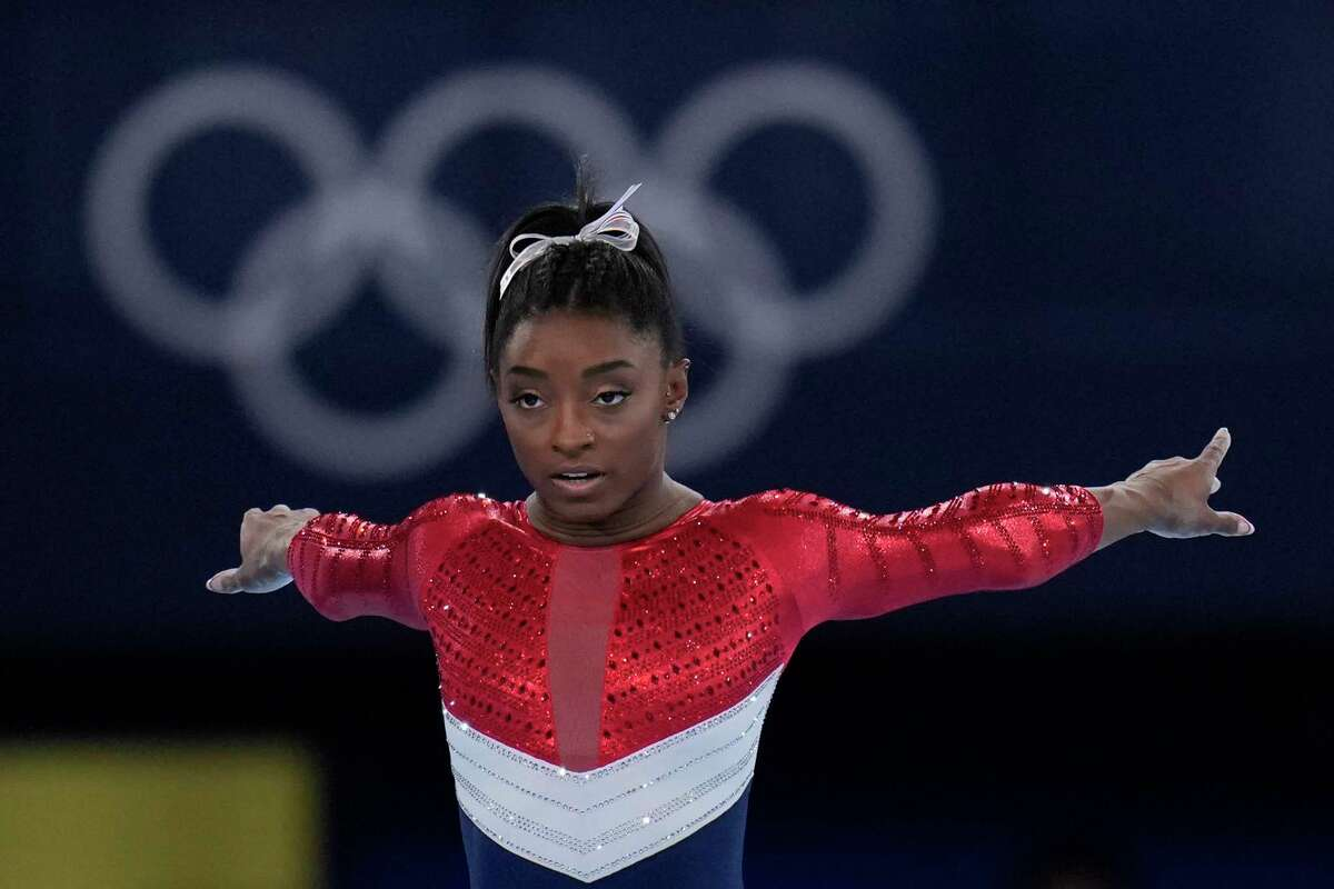 Simone Biles, of the United States, waits to perform on the vault during the artistic gymnastics women's final at the 2020 Summer Olympics, Tuesday, July 27, 2021, in Tokyo. (AP Photo/Gregory Bull)