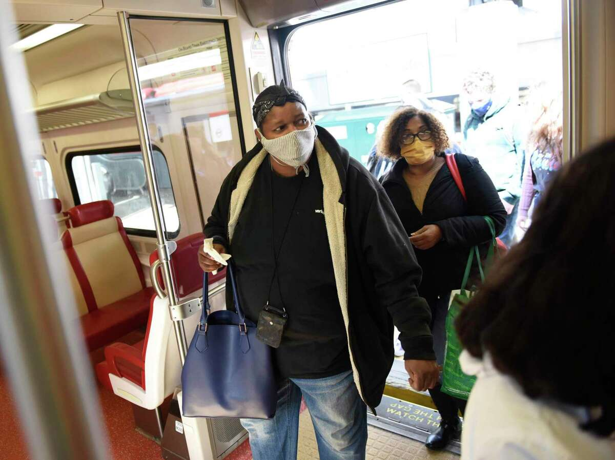 Passengers board a Metro-North train bound for Grand Central Terminal at the Stamford Transportation Center in Stamford, Conn. Wednesday, April 7, 2021.