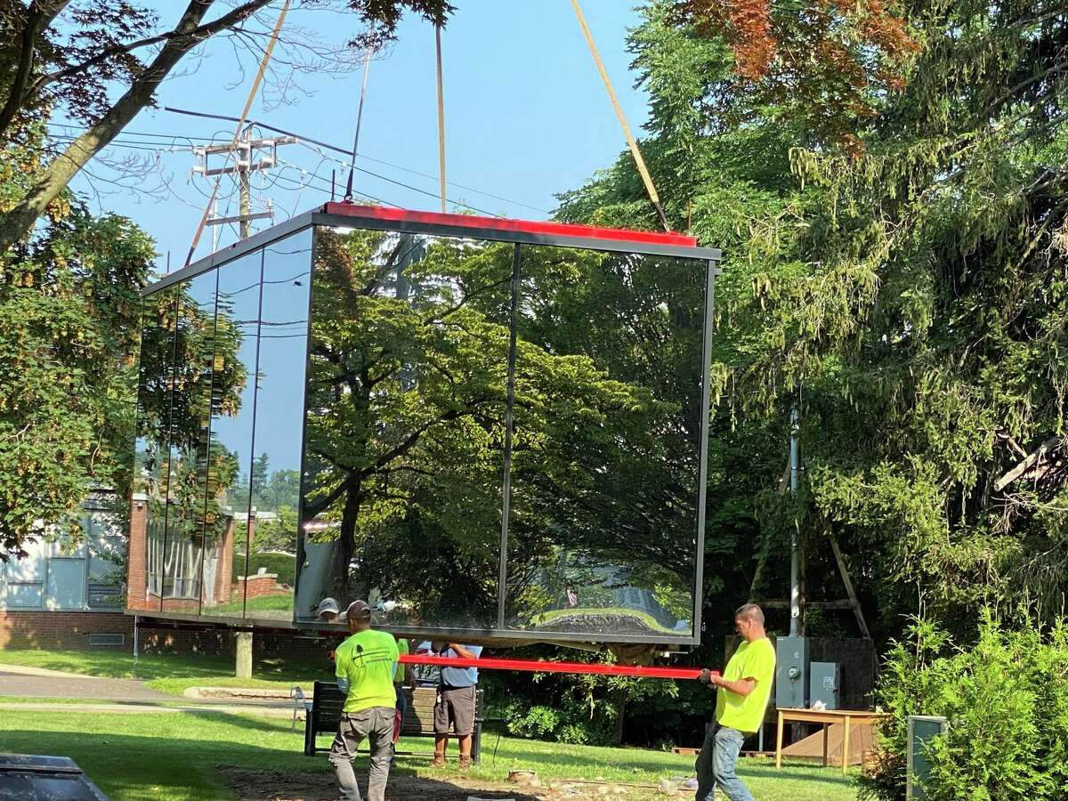 The mirror cube was removed from its home on South Avenue and Maple Street on Tuesday, July 27, where is was used to promote the new New Canaan Library project.