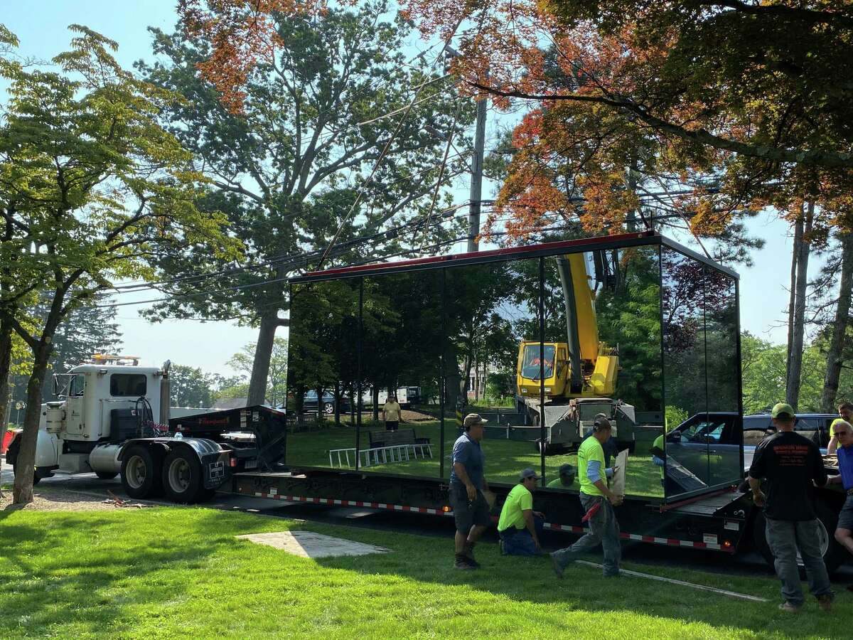 The mirror cube was removed from its home on South Avenue and Maple Street, where is was used to promote the new New Canaan Library project.
