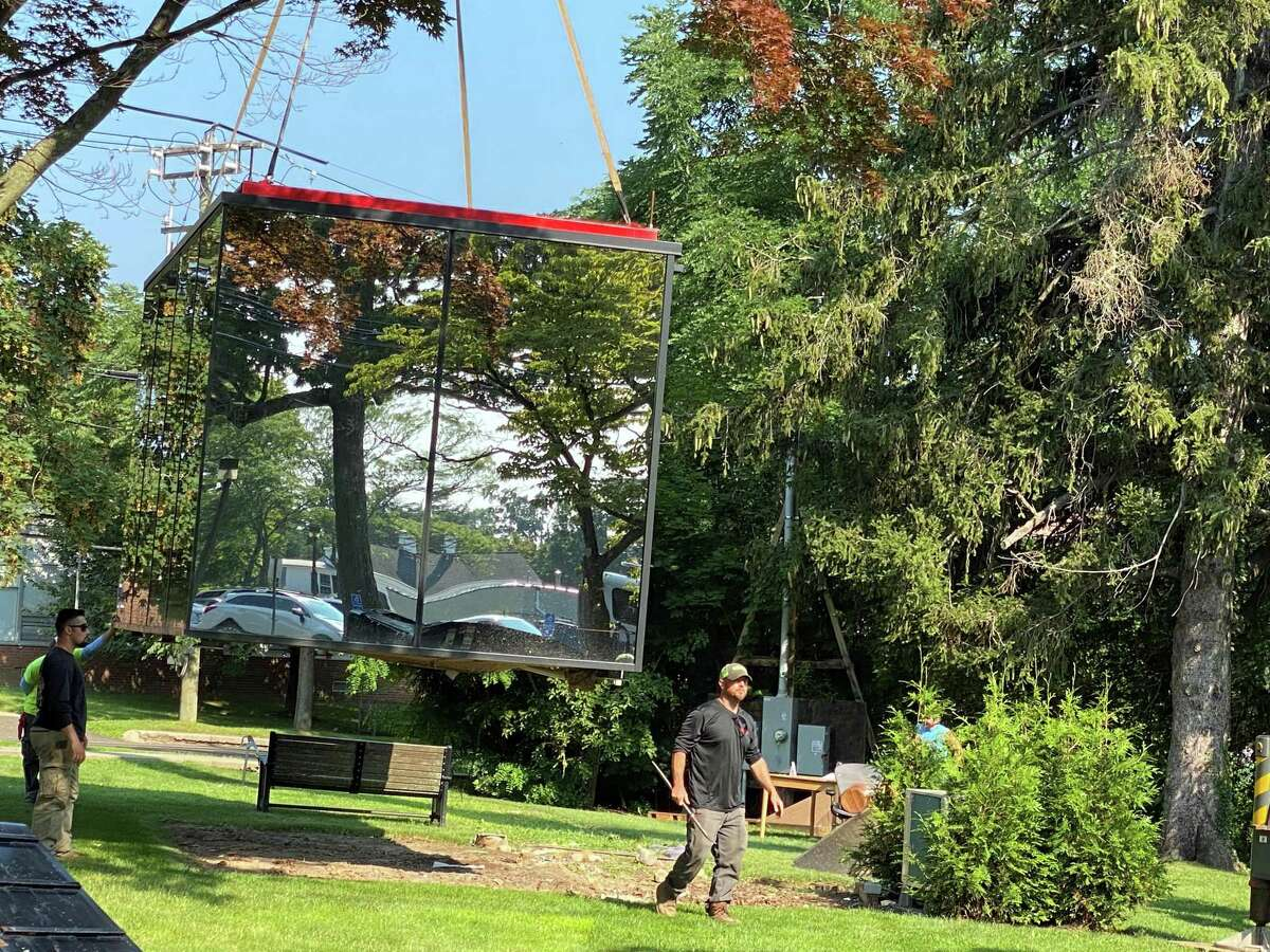 The mirror cube has been taken to a private home in Fairfield County. It was used to promote the new New Canaan Library project, which it sits next to.