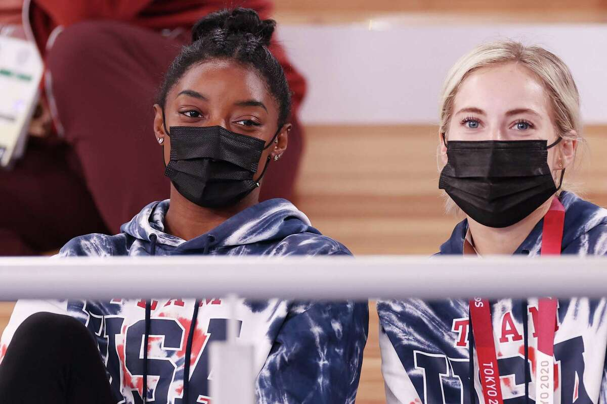 TOKYO, JAPAN - JULY 28: Simone Biles and MyKayla Skinner of Team United States watch the Men's All-Around Final on day five of the Tokyo 2020 Olympic Games at Ariake Gymnastics Centre on July 28, 2021 in Tokyo, Japan. (Photo by Jamie Squire/Getty Images)