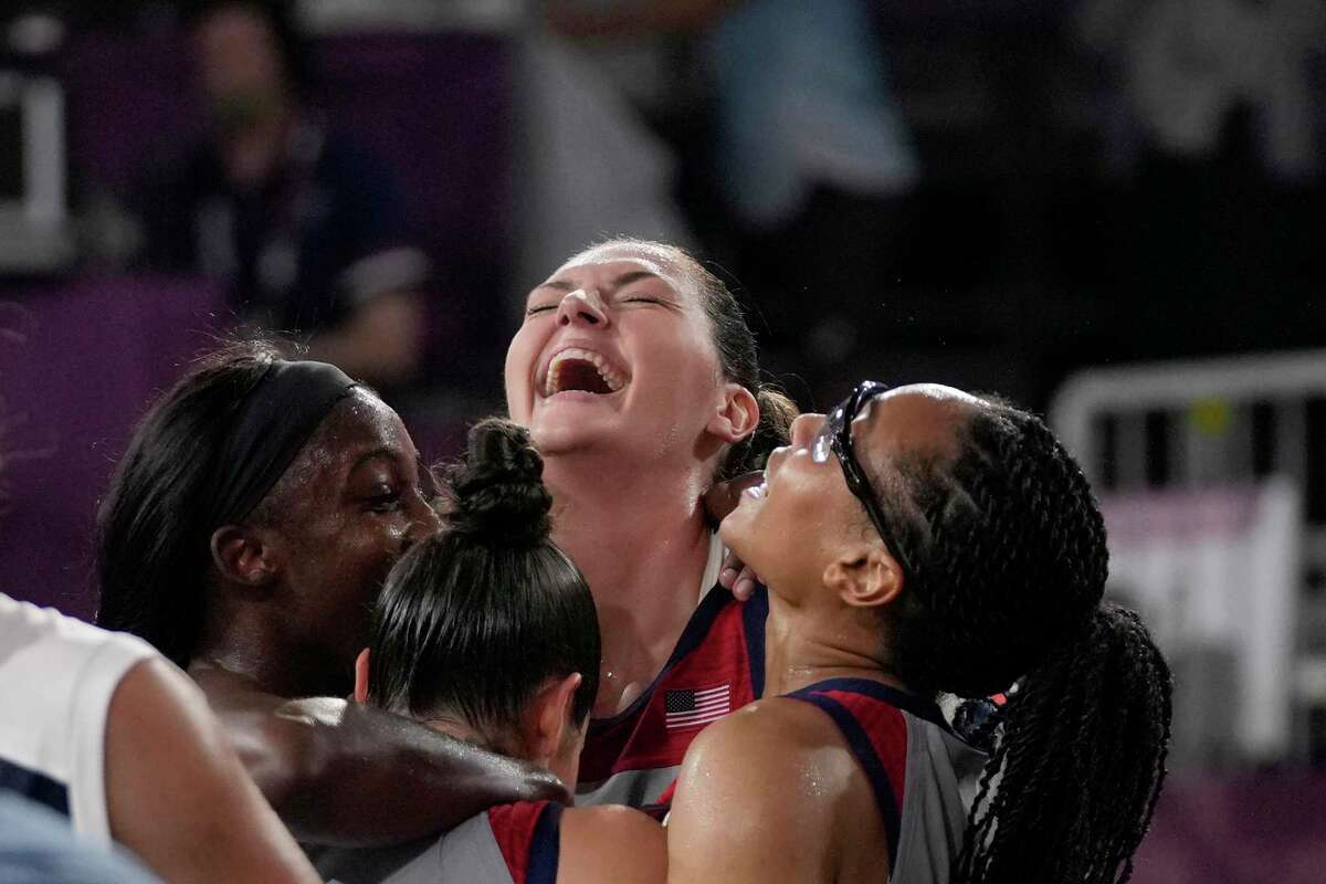 United States' Stefanie Dolson, top, celebrates with teammates Jackie Young, left, Kelsey Plum and Allisha Gray, right, after defeating Russian Olympic Committee in a women's 3-on-3 gold medal basketball game at the 2020 Summer Olympics, Wednesday, July 28, 2021, in Tokyo.