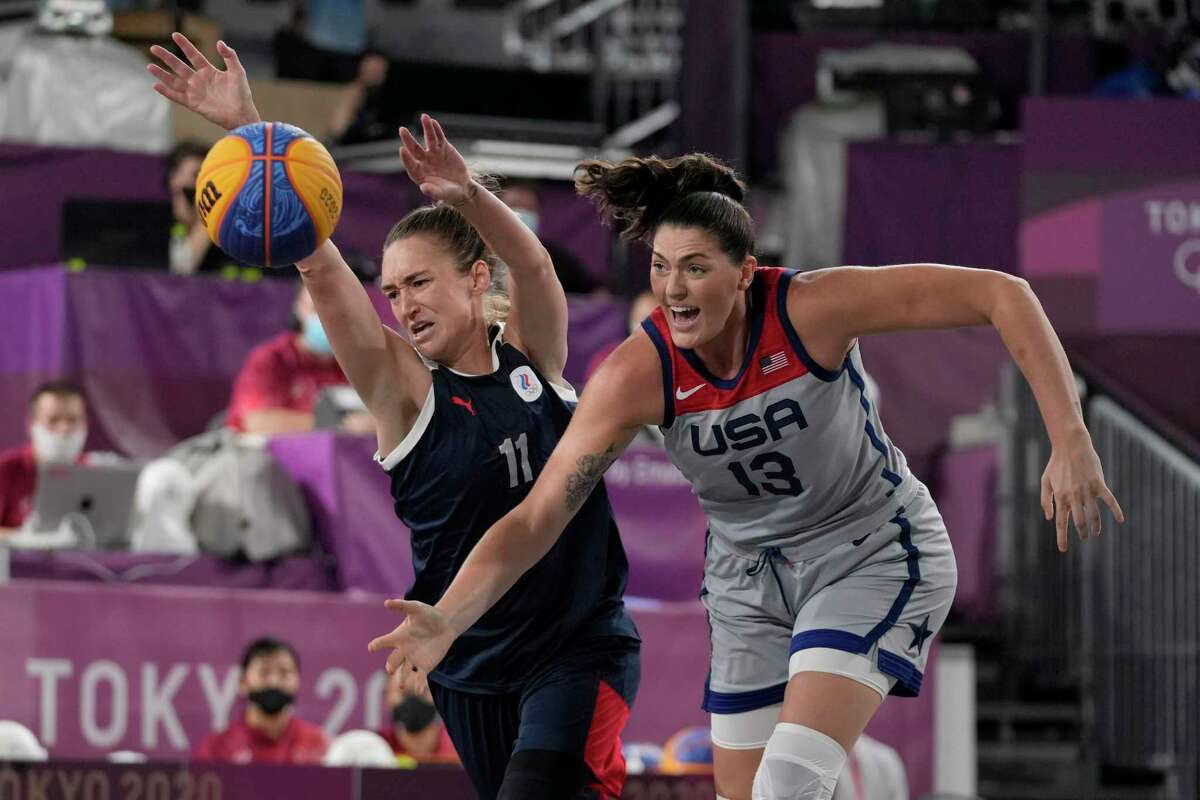 Anastasiia Logunova (11), of the Russian Olympic Committee, and United States' Stefanie Dolson (13) chase a loose ball during a women's 3-on-3 gold medal basketball game at the 2020 Summer Olympics, Wednesday, July 28, 2021, in Tokyo.
