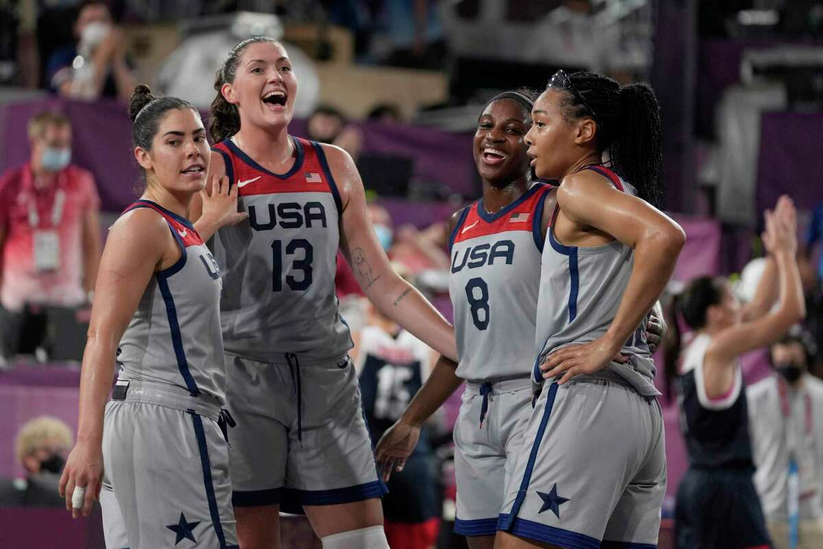 United States' Kelsey Plum, left, Stefanie Dolson (13), Jackie Young (8) and Allisha Gray celebrate after defeating Russian Olympic Committee in a women's 3-on-3 gold medal basketball game at the 2020 Summer Olympics, Wednesday, July 28, 2021, in Tokyo.