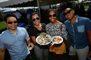 Visitors including Chooey Kua, Christina Fang, Manasa Kannegani and Jonathan Lee of NYC enjoy the Norwalk Seaport Association 42nd annual Oyster Festival Saturday, September 7, 2019, in Norwalk, Conn.
