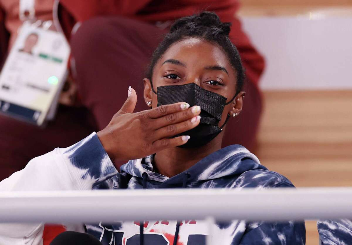 Simone Biles of Team United States blows a kiss whilst watching the Men's All-Around Final on day five of the Tokyo 2020 Olympic Games at Ariake Gymnastics Centre on July 28, 2021 in Tokyo, Japan.