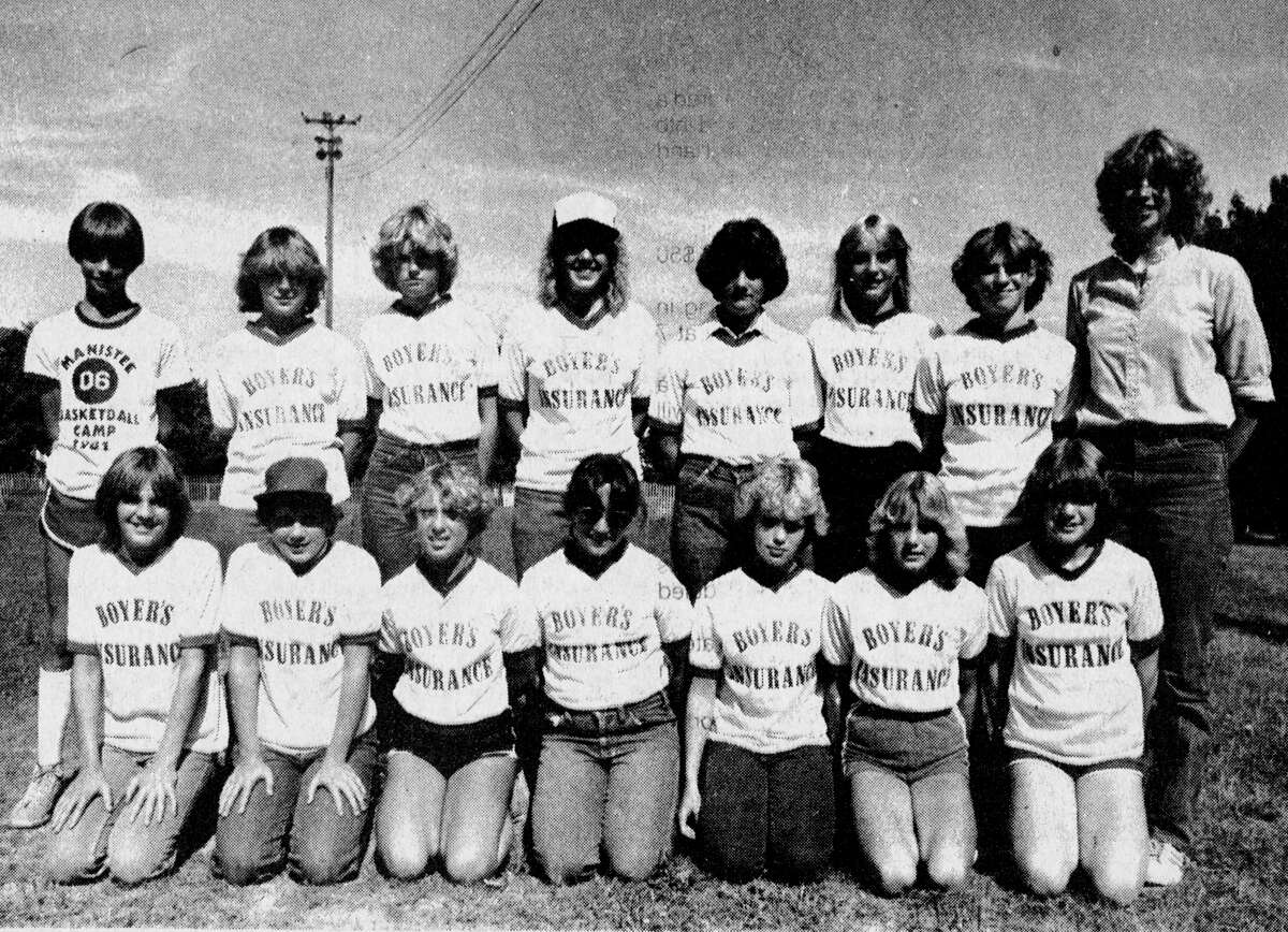 Boyer Insurance won the Junior High Girls' Softball championship in the Manistee Recreation Association summer league, finishing 6-2-1. (Front row, from left) Kelly Partridge, Kari Rae Snyder, Ann Skiera, Sandy Bajtka, Iris Nielsen, Roxanne Evens and Laura Senters. (Back row, from left) Assistant Coach Dan Howells, Connie Anderson, Lisa Deising, Beth Hanson, Jackie Michales, Kristy Ketz, Chris White and Coach Sarah Howells. Missing from thephoto isLisa Anderson, Kim Nowak, Michelle Schultz, Evamarie Buskirk and Kellie Bishop. The photo was published in the News Advocate on July 29, 1981. (Manistee County Historical Museum photo)