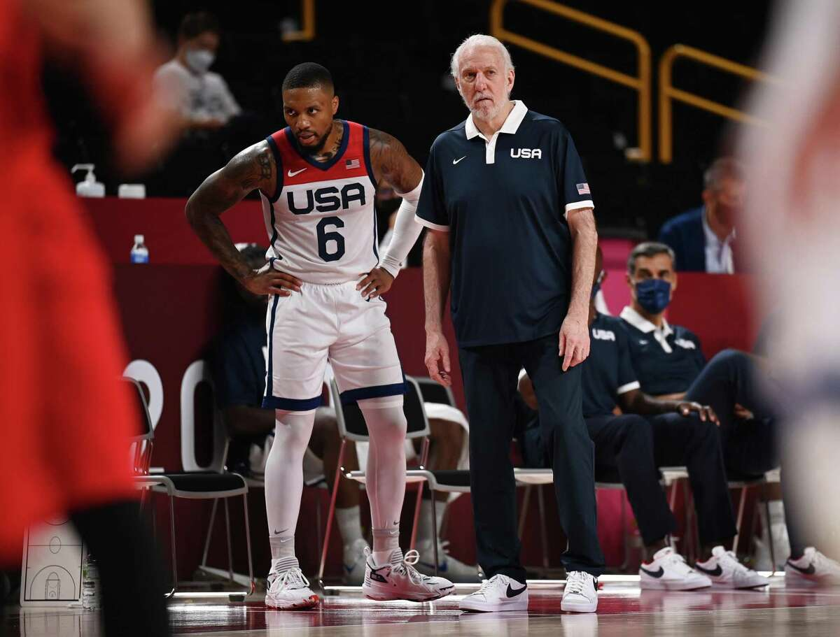 SAITAMA, JAPAN - JULY 28: Head Coach of Team United States Gregg Popovich speaks with Damian Lillard #6 during a Men's Preliminary Round Group A game on day five of the Tokyo 2020 Olympic Games at Saitama Super Arena on July 28, 2021 in Saitama, Japan. (Photo by Matthias Hangst/Getty Images)
