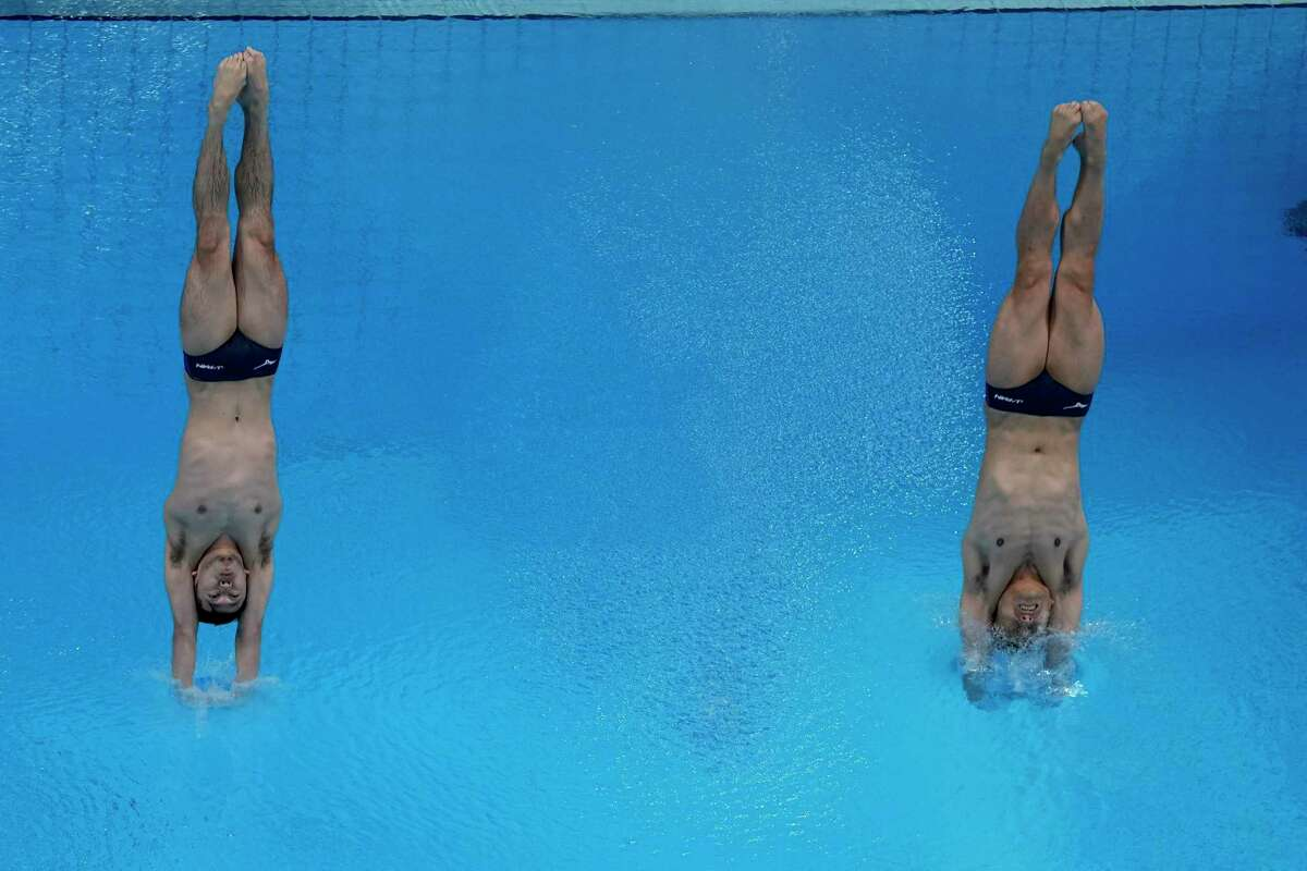 Japan's Sho Sakai and Ken Terauchi compete during men's synchronised 3-meter springboard at the 2020 Summer Olympics, Monday, July 26, 2021, in Tokyo, Japan.