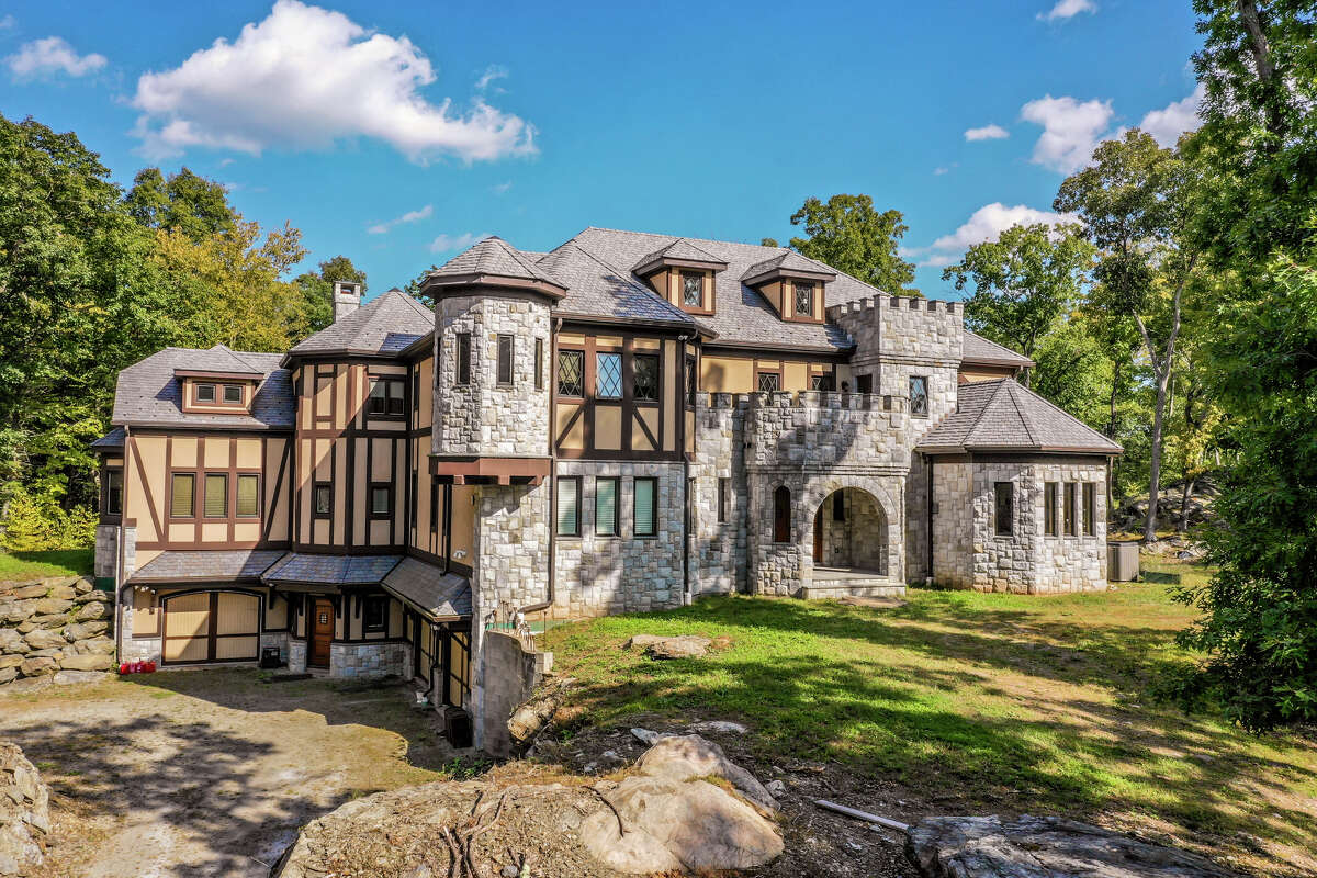 The home on 8 Beach Hill Road Westwas custom built in a stone castle-style and has 7,000 square feet of living space. View listing