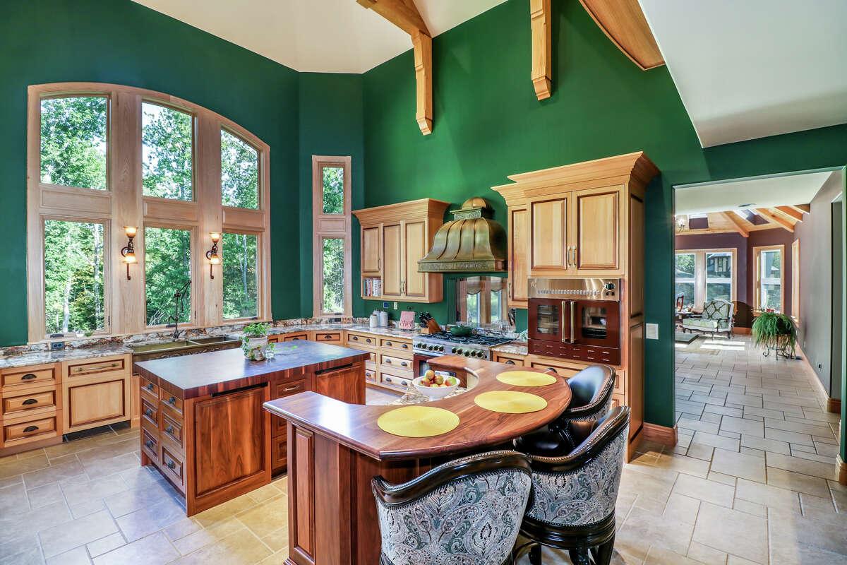 The kitchenhas a custom bronze hood and a professional-grade range. View listing