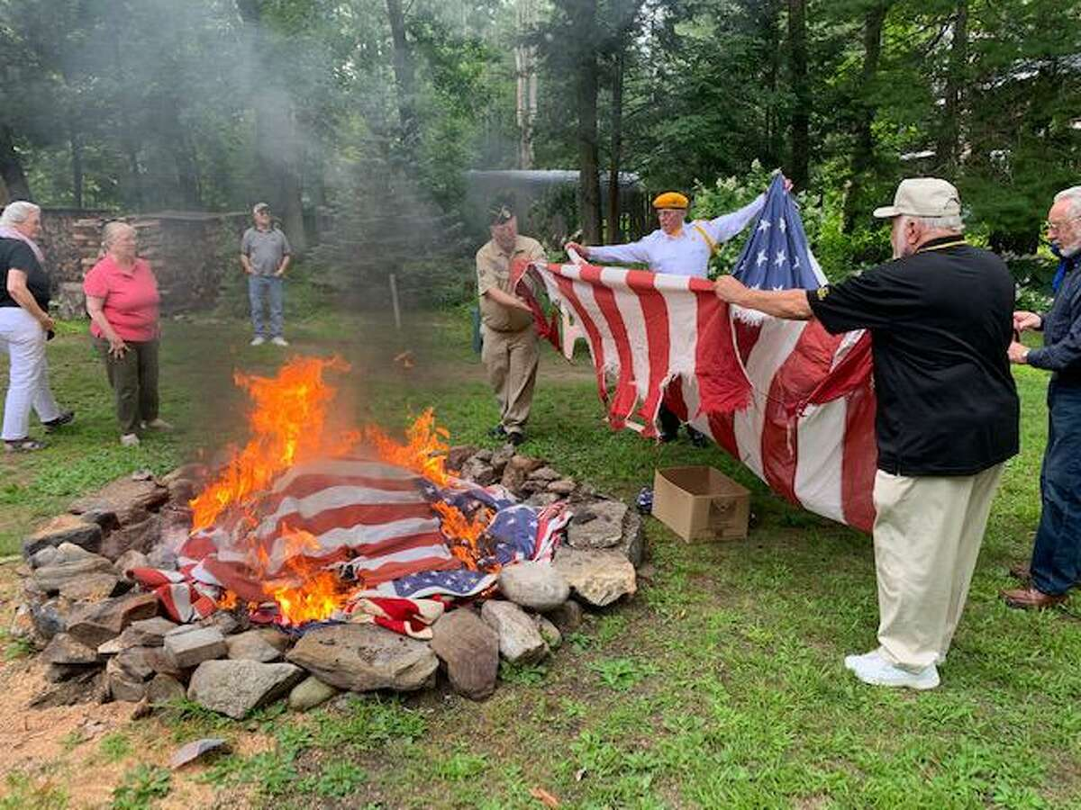 Members of the Barkhamsted Lions Club held a flag retirement event July 24.