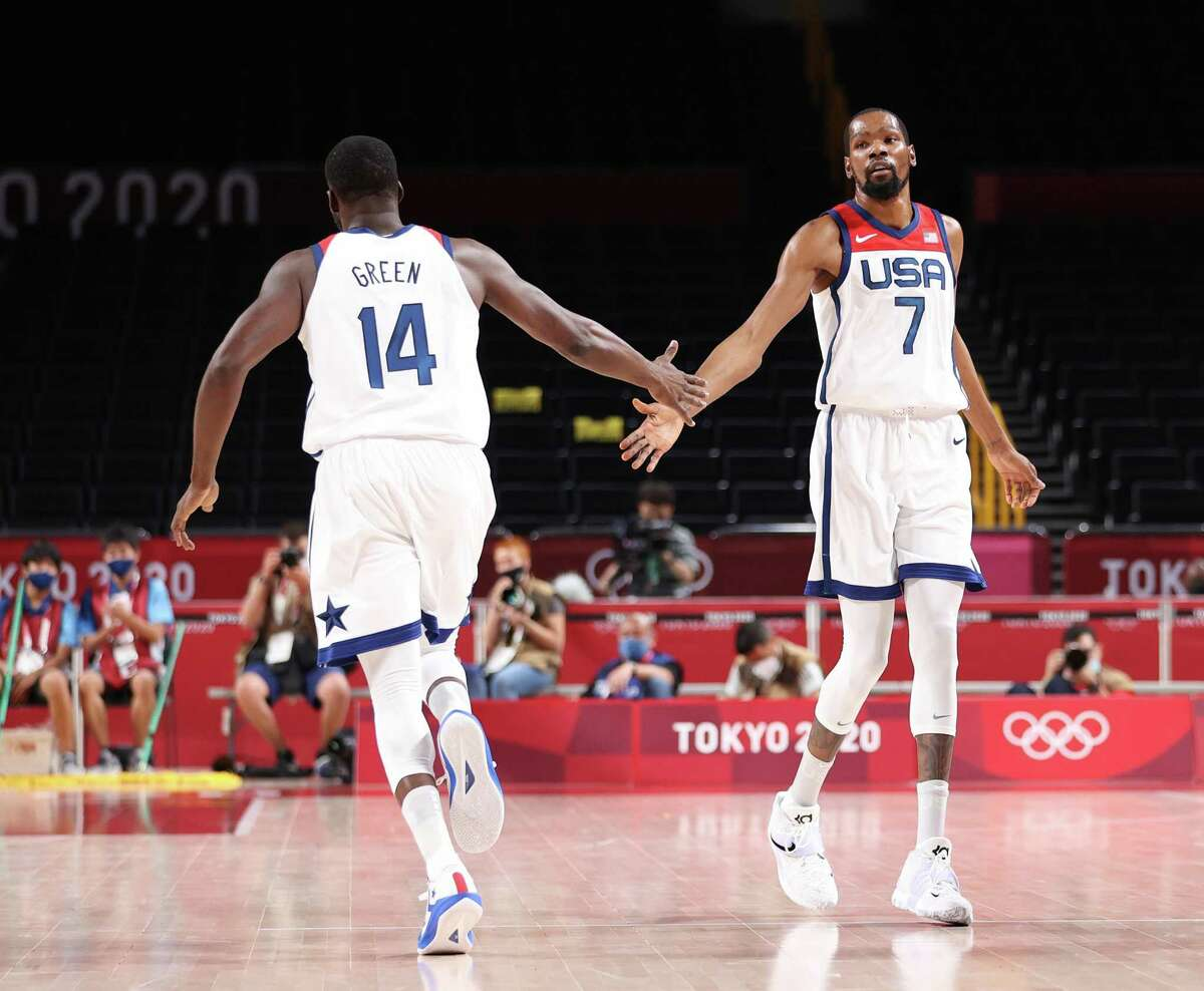SAITAMA, JAPAN - JULY 28: Kevin Durant #7 and Draymond Green #14 of Team United States celebrate against Islamic Republic of Iran during the first half of a Men's Preliminary Round Group A game on day five of the Tokyo 2020 Olympic Games at Saitama Super Arena on July 28, 2021 in Saitama, Japan. (Photo by Gregory Shamus/Getty Images)