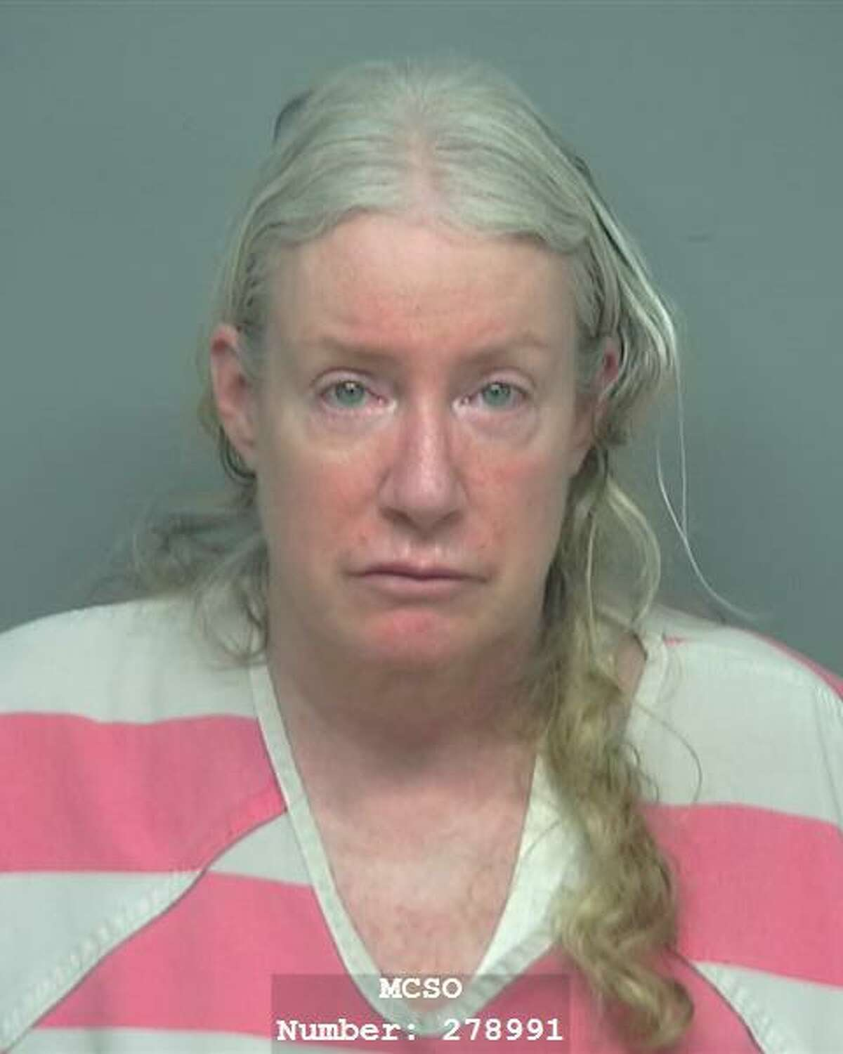 Barbara Ann Kenney, 57, of Spring, is charged with murder in the death of her husband, which officers found lifeless in their backyard.