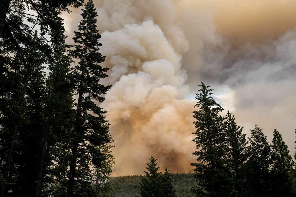 The Dixie Fire burns in Lassen National Forest, Calif., near Jonesville on Monday, July 26, 2021.