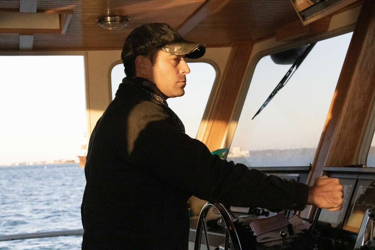 Jimmy Bloom navigating one of the fishing vessels.