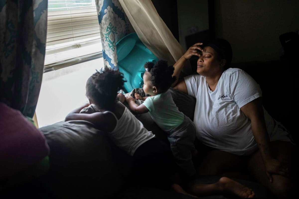 Brittany Baker takes care of her children Aubriana, 4, and Kaitlyn, 1, at home in Dayton, Ohio, on July 8, 2021.