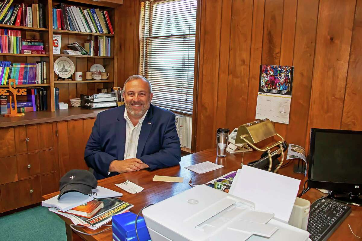 Colonel Ken Rathje, Jr. Ret., sits in the office of the Caseville United Methodist Church, where he will be an intern for the remainder of the summer months. (Bill Diller/For the Tribune)