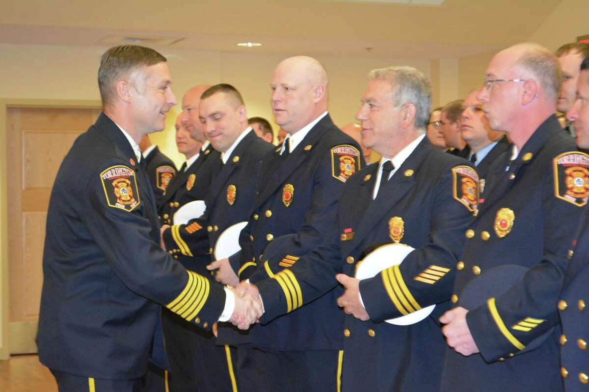 Torrington Fire Chief Peter Towey, left, is welcomed by members of the Torrington Fire Department in 2018. Towey announced his plans to take a job in New Britain this week, effective Aug. 15.