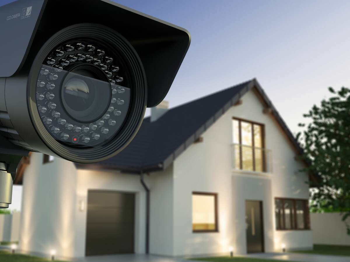 Security system with surveillance camera. Home pictured is not the rental discussed in the story.